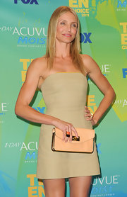 Cameron Diaz donned a nude mini dress for the 2011 Teen Choice Awards. She finished off the look with chic cocktail rings.
