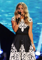 Kaley Cuoco hosted the Teen Choice Awards in style with a flirty dress that she paired with a white diamond statement cuff bracelet.