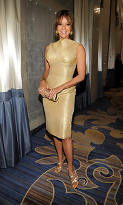 Eva was chic in gold at the Unicef ball. She paired the look with metallic strappy sandals.