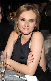 Diane Kruger wore shimmering metallic red-raspberry nail polish at the 2011 UNICEF Ball.