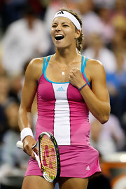 Maria Kirilenko wore a white headband to help kep her hair out of her face.