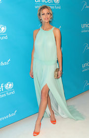 Brooklyn Decker punched up her red carpet ensemble with orange peep-toe pumps.