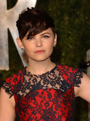 Ginnifer Goodwin kept her accessorizes simple, opting for a classic pair of gemstone stud earrings at the 2011 'Vanity Fair' Oscar Party.