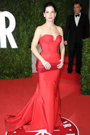 Sandra Bullock matched her red Oscar gown with a rectangular crocodile clutch.