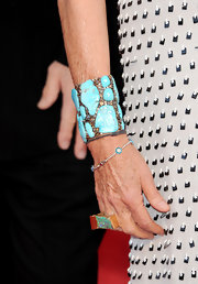 Diane offset her printed dress with a turqouise stone bangle bracelet.