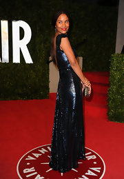 Joy Bryant looked undeniably glamorous at the 'Vanity Fair' Oscar party carrying a petite gold studded clutch.