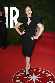 Vera went for a dramatic LBD with exaggerated shoulders and a plunging key-hole neckline at the Vanity Fair Oscar party.