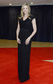 Mira Sorvino looked downright elegant in her black cowl-neck evening dress with beaded detailing.