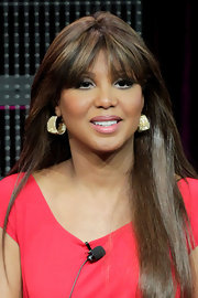 Toni Braxton wore gold chunky hoop earrings at the 2011 Winter TCA Tour.