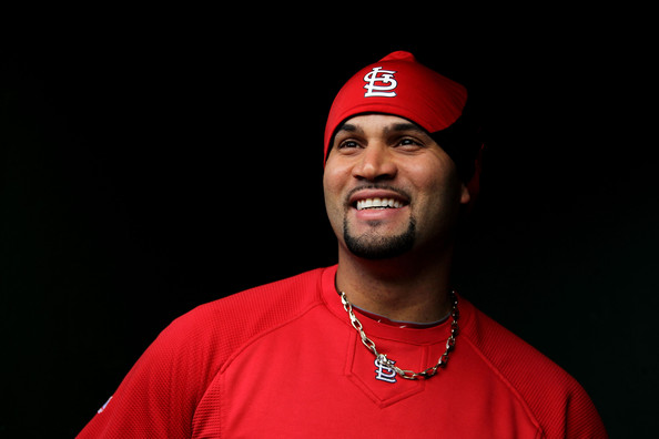 Albert Pujols wore a beanie hat with the St Louis Cardinals logo on in for the 2011 World Series Game 2.