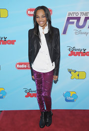 China Anne McClain looked ladylike wearing a leather jacket over a ruffled blouse at a Disney Channel event.