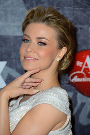 Carmen Electra painted her talon-like nails in a matte beige hue.