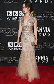 Berenice looked splendid in the waist-cinching gold sequined dress at the BAFTA Britannia Awards.