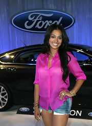 La La Anthony paired a sheer pink button-down with a pair of cutoffs for her visit to the Ford Hot Spot Room.