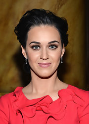 Katy Perry debuted a more pared-down, feminine hairstyle at the 2012 Billboard Women in Music Luncheon, which featured lots of volume up top with a bundle of curls in the back.