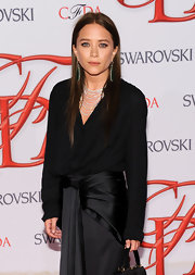 Mary-Kate Olsen's new dark tresses looked sleek in a straight center part.