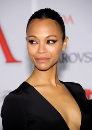 Zoe Saldana smoldered at the CFDA Awards with her metallic winged cat eyes.