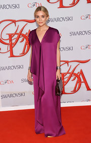 Ashley Olsen went for a vibrant look at the CFDA Awards draped in her own silk fuchsia design.