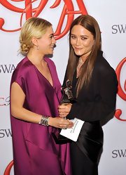 Ashley Olsen wore her hair in a messy bun by the nape of her neck when she and sister Mary-Kate won a CFDA Fashion Award.