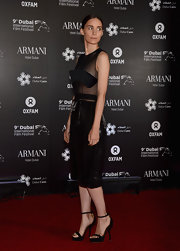 Rooney Mara posed for photos on the red carpet in a pair of strappy, black high-heeled sandals.