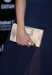 Livia Firth held a pale gold satin clutch at the 2012 Dubai International Film Festival.
