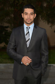 Wilmer Valderama wore a striped satin tie to match his gray suit.