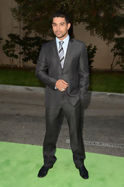 Wilmer Valderama posed for a photo wearing a nice sleek gray suit at the Environmental Media Awards.