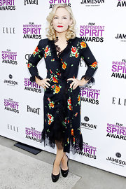 Rachael Harris paired her floral frock with black leather platform pumps.