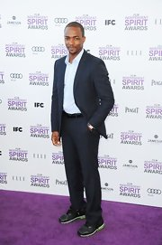 These sneakers were an unexpected twist for a suit, but the kick of neon green kept Anthony Mackie looking slick!