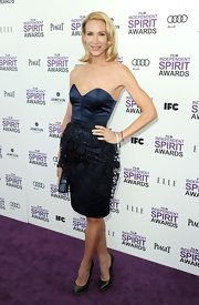 Kelly Lynch wore this strapless cocktail dress with a sweetheart neckline and embroidered overlay to the Independent Spirit Awards.