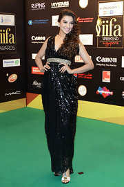 Gauhar Khan looked like a goddess in her sequined black drape dress.