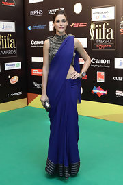 Nagris Fakhri carried a metallic clutch with her stunning ensemble.