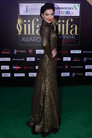 Gauhar Khan dazzled in a long-sleeve glittery evening dress.