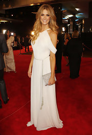 Delta Goodrem added some sparkle to her Logie Awards look with a bejeweled silver clutch.