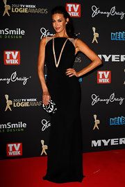 Megan Gale looked subtly sexy at the 2012 Logie Awards in a black evening dress with a V-shaped peekaboo panel.