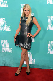 Not one to miss an MTV soiree, Paris Hilton made an appearance in this heavily embellished gunmetal mini with a dangerous spiked clutch.