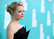 Emma Stone went back to blond with this wavy side-swept chignon at the MTV Movie Awards.