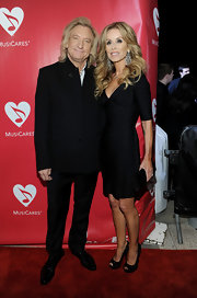 Marjorie Bach heated up the MusiCares red carpet in an alluring black bandage dress.