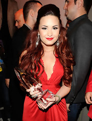 Demi Lovato wore her hair in a voluminous half-up, half-down 'do with long flowing curls at the 2012 People's Choice Awards.