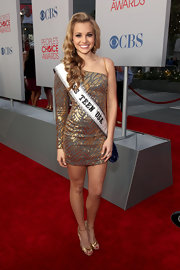 Danielle Doty proudly wore her Miss Teen USA banner over her single-sleeved gold cocktail dress at the People's Choice Awards.
