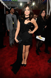 To match her dark romantic People's Choice Awards look, Lucy Hale accessorized with a black crystal Midnight clutch.