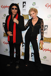 Shannon Tweed arrived at the 2012 Revolver Golden Gods Award wearing slacks and a lacy fitted top.