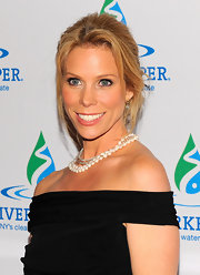 Cheryl Hines wore her hair swept back in a casual updo with long wispy bangs and loose tendrils for the 2012 Riverkeeper's Fishermen's Ball.