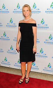Cheryl Hines paired her sexy LBD with even sexier strappy black sandals.