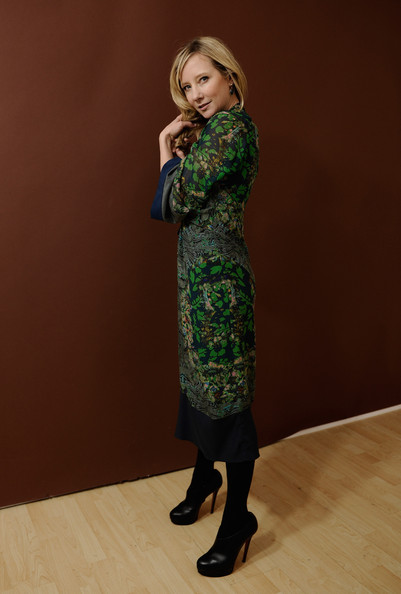 Anne paired her printed frock with black leather platform pumps.
