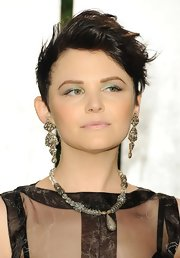 Ginnifer Goodwin attended the 2012 Vanity Fair Oscar Party wearing her short razored cut in a cool tousled style.