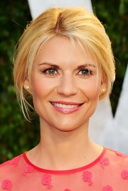 Claire Danes attended the 2012 Vanity Fair Oscar Party wearing a shimmery pink lipstick topped with a super-shiny gloss.