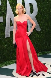 Kelly Lynch added drama to her sexy red gown with black platform sandals.