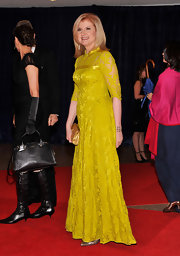 Arianna Huffington stood out on the red carpet in this chartreuse lace collared gown.