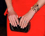 Elizabeth Banks carried a gold and black clutch to match her statement bracelet for the White House Correspondents' Dinner.